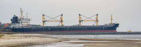 BLACK BULK CARRIER. The great bulk carrier flows into the sea royalty free stock images