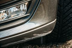 Black Bumper Car Scratched, Deep Damage To Paint Royalty Free Stock Images