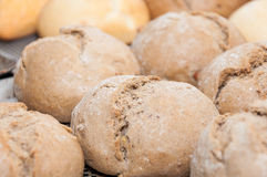 Black buns. Natural black bread/buns with on production tape royalty free stock images