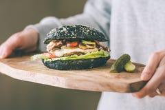 Black burger stock photos