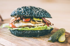 Black burger Royalty Free Stock Photography