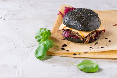 Black burger with stews Royalty Free Stock Photos