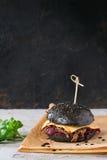 Black burger with stews Stock Photos