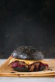 Black burger with stews Royalty Free Stock Photography