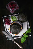 Black burger with stews Royalty Free Stock Image
