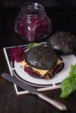 Black burger with stews Stock Photo