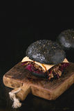 Black burger with stews Stock Image