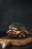 Black burger with stews Royalty Free Stock Images