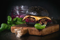 Black burger with stews Stock Images