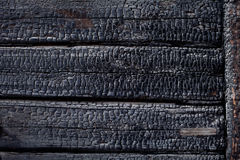 Black burned charred burnt wood background texture Stock Photo