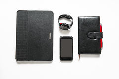 Black business accessories on the table. Black business accessories on white table Stock Image
