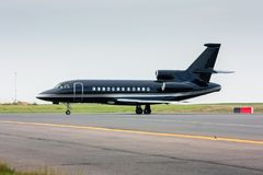 Black business jet taxiing from the runway Royalty Free Stock Images