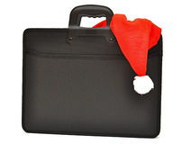 Black business briefcase with Santa's hat Royalty Free Stock Images