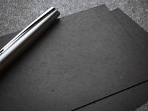 Black business card with luxury silver pen Stock Photo
