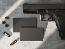 Black business cards on concrete floor with gun and bullets. 3d rendering Royalty Free Stock Photo