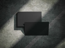 Black business cards on the stone floor. 3d rendering. Black business cards on the stone floor and shadows. 3d rendering Stock Images