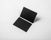 Black business cards on a white background. Identity design, corporate templates, company style. Horizontal Stock Image