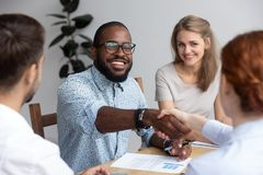 Black business coach greeting company owner female boss during c. Diverse businesspeople during seminar, black business trainer greeting female company executive stock photos