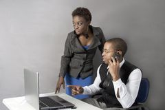 Black Business couple in office shaking hands. Royalty Free Stock Photography