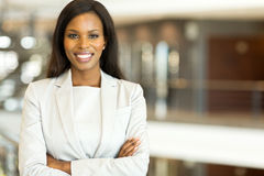 Black business executive. Attractive black business executive with arms crossed Royalty Free Stock Images