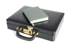 Black business leather Briefcase with book Royalty Free Stock Photo