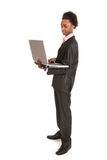 Black business man with laptop Royalty Free Stock Photography