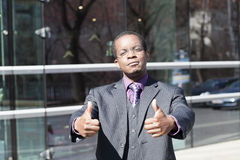 Black business man with thumbs up Royalty Free Stock Photos