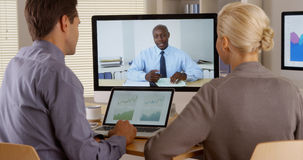 Black business manager remotely talking to employees. In office Royalty Free Stock Photography