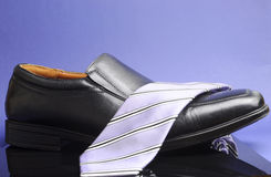Black business mans shoe with lavendar srtipe neck tie Royalty Free Stock Photo