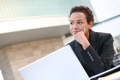 Black Business Woman. A pretty african american business woman on computer stock image
