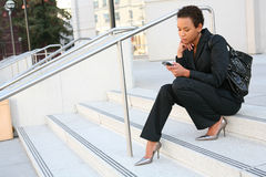 Black Business Woman. A pretty african american business woman at her company stock photo
