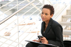 Black Business Woman. A pretty african american business woman at her company stock photos