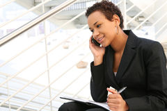 Black Business Woman. A pretty african american business woman at her company royalty free stock image