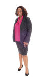 Black business woman. An African American business woman standing in profile for white background and smiling stock photo