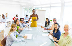 Black Business Woman in Conference with Associates Royalty Free Stock Photography