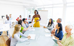 Black Business woman in conference with associates Royalty Free Stock Photo
