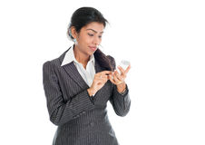 Black business woman using smartphone. Texting and smiling, on white background stock image