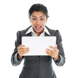 Black business woman using tablet pc. And getting shocked, on white background stock photos