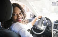 Black Business woman on a white car. A black business woman on a white car stock photography