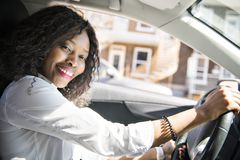 Black Business woman on a white car. A black business woman on a white car stock photos