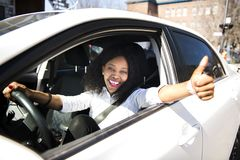 Black Business woman on a white car. A black business woman on a white car stock image