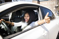Black Business woman on a white car. A black business woman on a white car royalty free stock image
