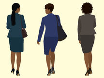Black business Women Walking Away. Black or African- American business Women wearing suits and carrying purses while Walking Away Royalty Free Stock Image