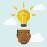 Black businessman with bulb on his head. A black businessman has a bright idea for marketing strategy with a bulb on his head. Human intelligence concept. A Stock Images