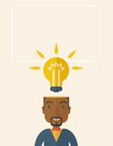 Black businessman with bulb on his head. A black businessman has a bright idea for marketing strategy with a bulb on his head. Human intelligence concept. A Stock Photo