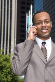 Black businessman on cell phone Stock Photos