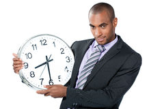 Black businessman with clock Stock Photos