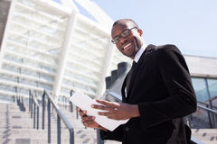 Black businessman documents handling Royalty Free Stock Images