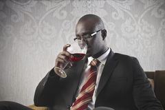 Black Businessman Drinking Wine stock photo