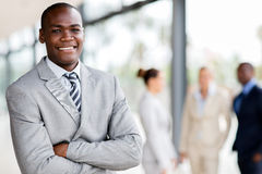 Black businessman executive. Handsome black businessman executive looking at the camera stock photo